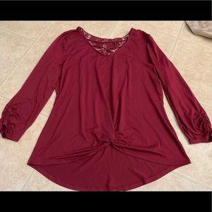 Beautiful burgundy tunic with design on back